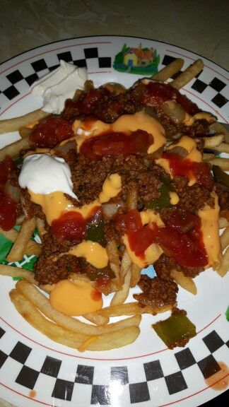 Made Taco Fries  Ground beef with one package of taco seasoning Tostitos cheese and salsa dip Green peppers and onions  Sour cream