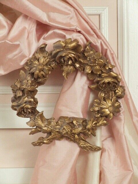 silk detail curtain with gold wreath to drape