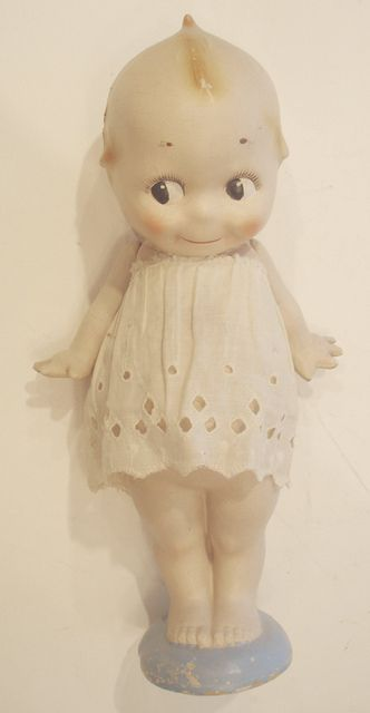 COMPOSITION KEWPIE DOLL. Kewpie doesn't need to wear clothes but when she does it's adorable-even if it's just a piece of lace.