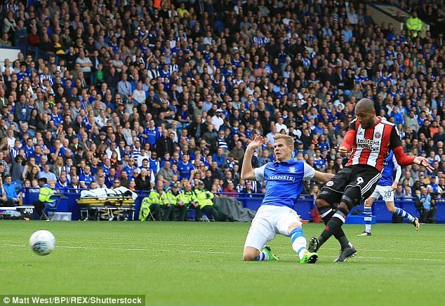 Leon Clarke puts his foot through the ball to score against his former club at Hillsborough