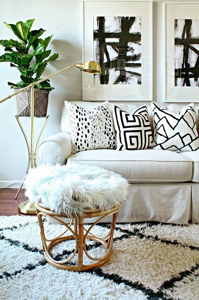 Front Room With Black And White, A Fur Stool, And A Beni Rug…