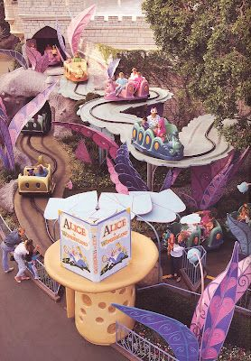 Vintage Disneyland, Alice ride.  Notice there are no railings on the side of the track.  I used to get out of this ride inside and run ahead of the car.   Climbing on teacups.  This was in the late 60's.