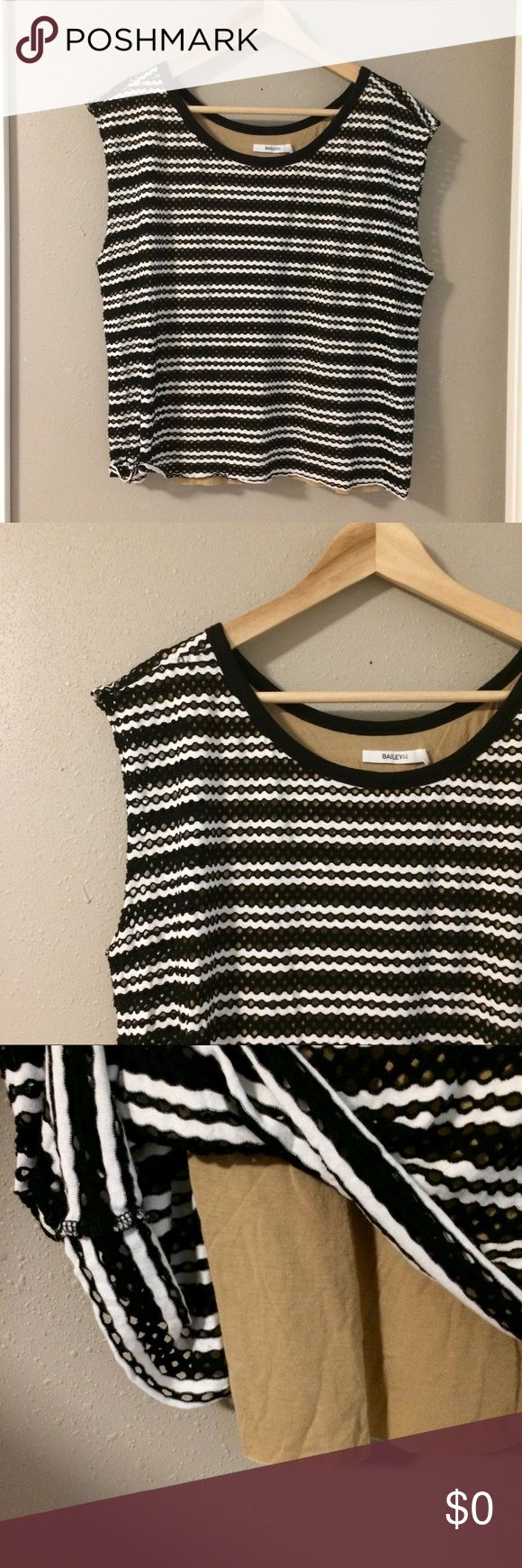 L Bailey 44 Top L Bailey 44 Top. Black and white stripes with circular cut outs and knit nude lining. Super cute!! Love with a jacket and favorite jeans for fall. Excellent pre-owned condition with the exception of a missing care label. Bundle for additional discounts and seller offers. Bailey 44 Tops