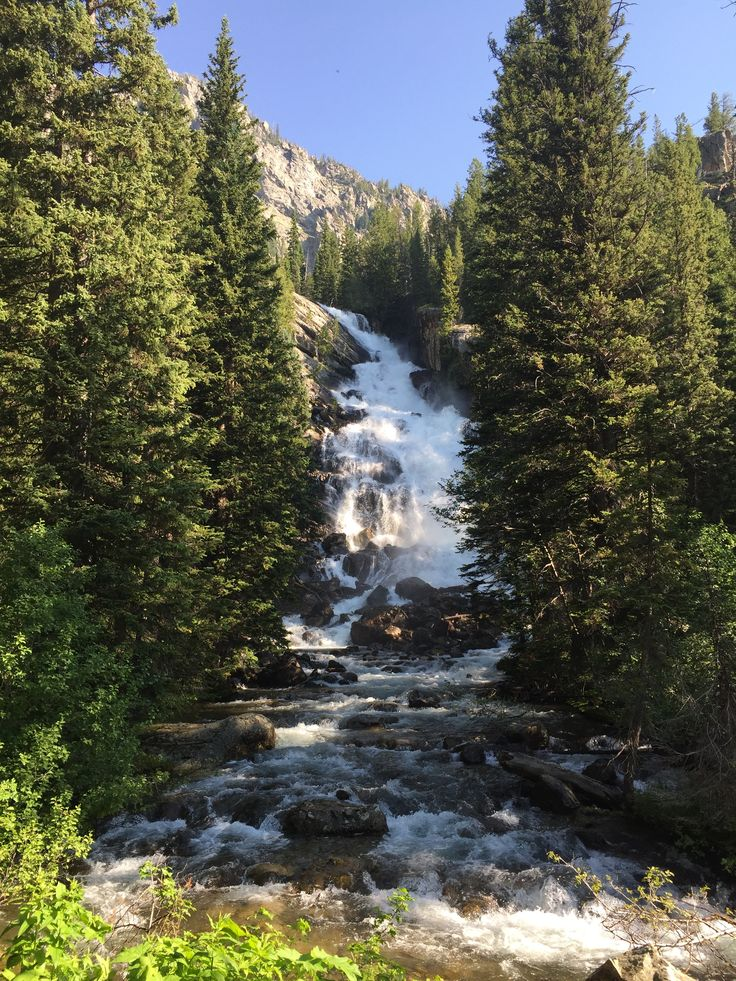 7 Day Road Trip Itinerary through Grand Teton and Yellowstone National Park - this is from day 2 at Hidden Falls.