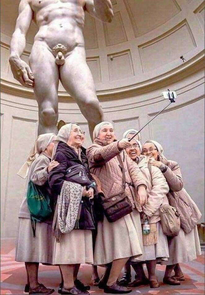A group of nuns take an epic museum selfie.