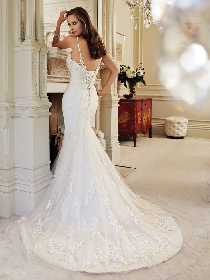 Style Y21444, Cloris, is a beautiful tulle sleeveless wedding dress with chapel train designed by Sophia Tolli, click here for more details.