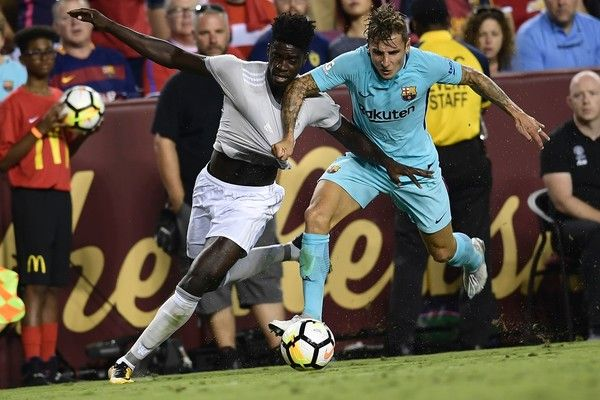 Manchester United's defender Axel Tuanzebe and Barcelona's defender Lucas Digne vie for the ball during their International Champions Cup (ICC) football match on July 26, 2017 at the FedExField, in Landover, Maryland.  / AFP PHOTO / Brendan Smialowski