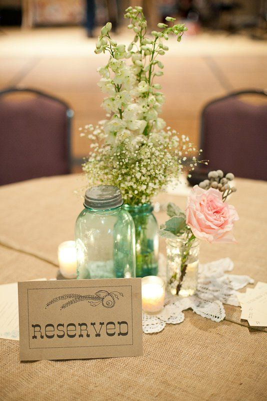 "An idea...kinda, sorta, not really (no blue Mason Jars, ""Reserved"" only for Parents, Grandparents, Aunties & Uncles & Sibs...and, Wedding Party?) Wedding centerpiece : Burlap tablecloth, vintage doilies, blue Mason jars"