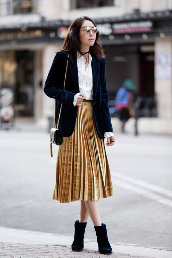 The Best Outfit Ideas Of The Week: Fashion blogger 'Fit Fab Fun Mom' wearing a navy velvet blazer, a white shirt, a golden velvet pleated skirt, blue velvet booties, a black shoulder bag and round mirror sunglasses. Fall outfit, casual outfit, work outfit, fall trends 2016, fall layers, velvet outfit, pleated skirt outfit, velvet blazer outfit, work outfit, office outfit, street style, edgy outfit, holiday outfit.
