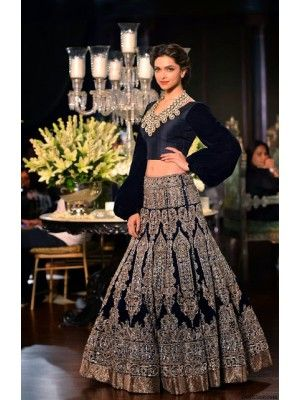 Deepika Padukon in Navy Blue Moss Velvet Designer Lehenga 2116 looked stunning teamed with full puffed sleeved choli. The heavy floral work, kalkatti embroidered with zari threads on all over the lehenga and a thik shimmer border giving it a royal look.Hot Deepika Padukone Sarees, Deepika Sarees, Buy Deepika Padukone Navel Sarees, Deepika Padukone Latest Black Lehenga Choli, Bollywood Replica Deepika Padukone Sarees,