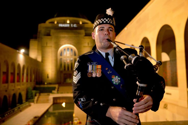 Police piper at the Australian War Memorial Canberra. Anzac Day 2015 photo curtesy Dept of Defence Australian Federal Police.