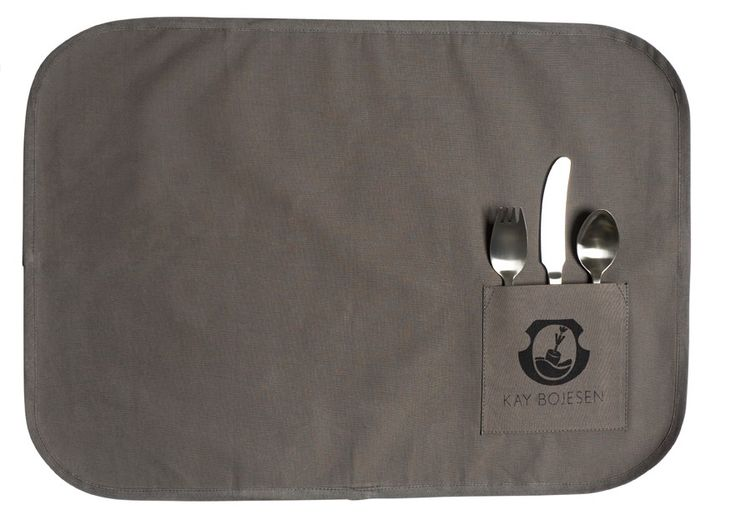The canvas placemat. Kay Bojesen Grand Prix child set 3-piece set consists of a spoon fork, a child knife, and a child spoon. Wrapped in a canvas placemat. Kay Bojesen Grand Prix cutlery / flatware. Danish design.