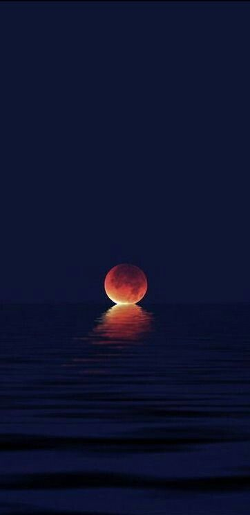 Moon kissing the ocean