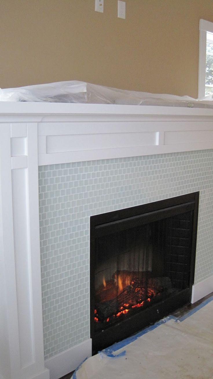 25 best ideas about glass tile fireplace on pinterest