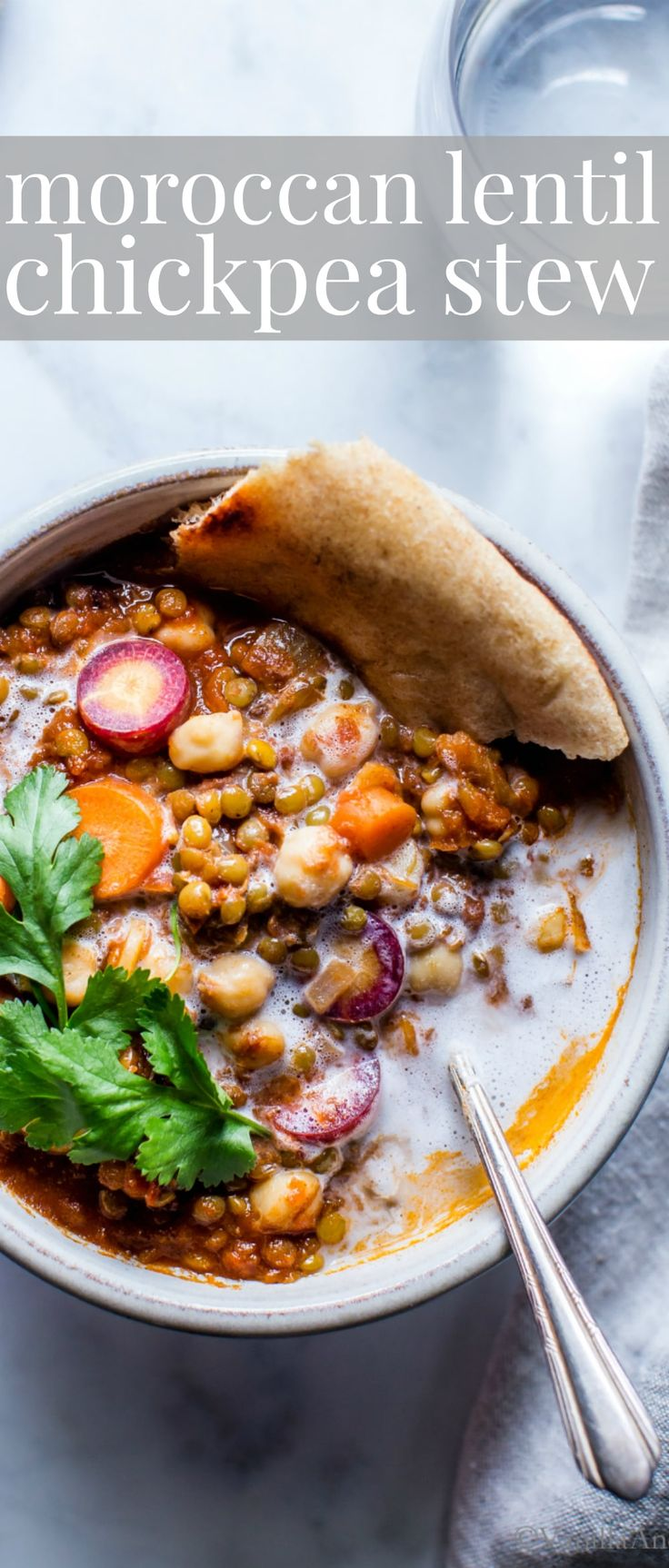 Simple ingredients, and texture rich with mouthwatering flavors; Moroccan Lentil Chickpea Stew comes together in about 45 minutes. With a dollop of coconut cream, a sprinkle of cilantro and flatbread, dinner is ready! vegan gluten free