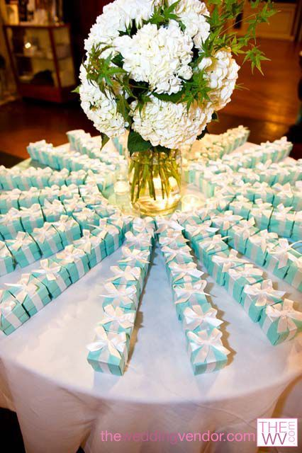 Tiffany blue wedding favor boxes from www.TheWV.com. Beautiful arrangement. Photo from Robert Holley Productions: