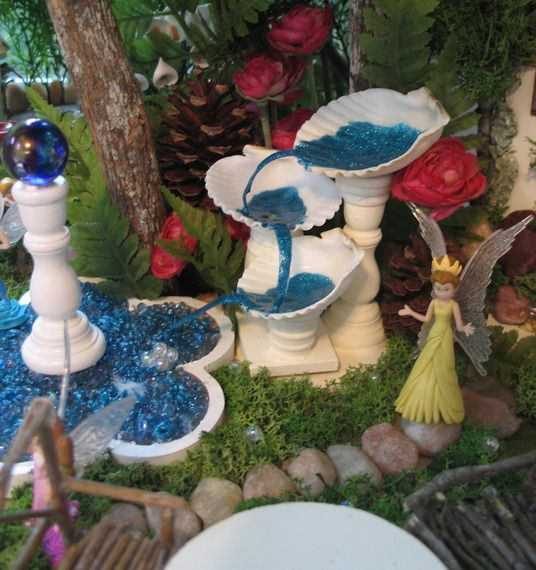 Sea shell fountain and gazing ball pool gardening for Garden mini pool