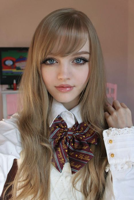 Beautiful doll face :)--it's amazing what makeup can do!! makes her big eyes look doll-like!