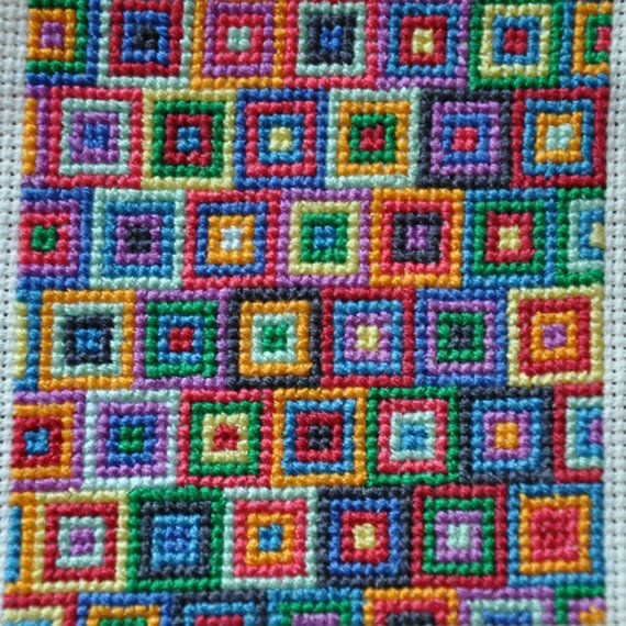 Cross stitch Squares - you don't need a pattern to follow just keep going till you run out of space, leave enough aida to make a hem and then work out what it will become, a cushion, book cover or whatever you desire.....