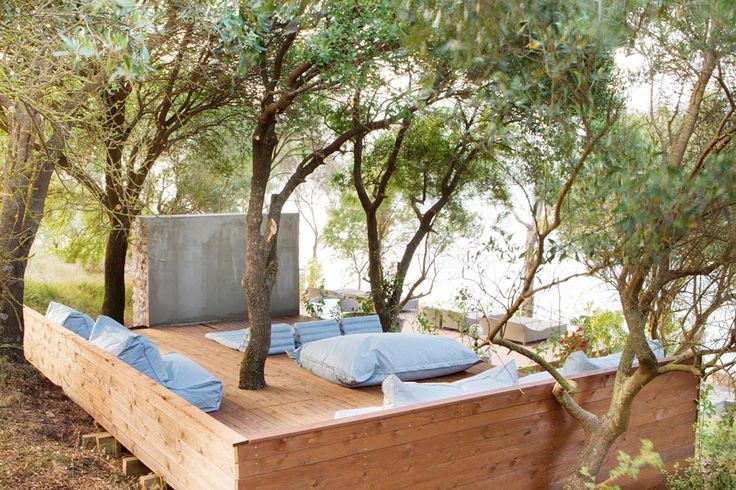 The outdoor cinema shaded by pernia trees. In the daytime this wooden decked platform is a perfect place to read and relax.
