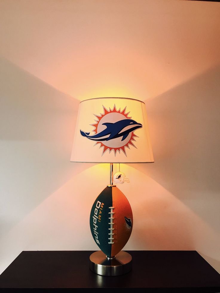 Miami Dolphins Lamp, man cave decor, sports lamp, kids night light, table lamp, football light, Dolphins light,  NFL, Football lamps, NFL Lamps, Miami, Dolphins, handmade, small business, arts and crafts, desk lamps, man Cave Decor, men gifts, football Decor, Florida football, pro football, art,  by CaliradoArt on Etsy https://www.etsy.com/listing/529461775/miami-dolphins-lamp-man-cave-decor