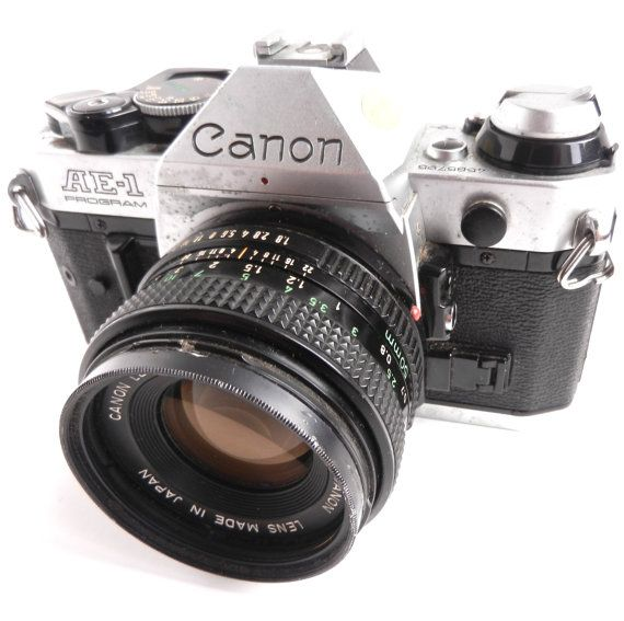 Vintage Canon  AE1 Program Film Camera - 1970s by MaejeanVINTAGE, $28.00 my first SLR I shot all my b/w prints till it was stolen