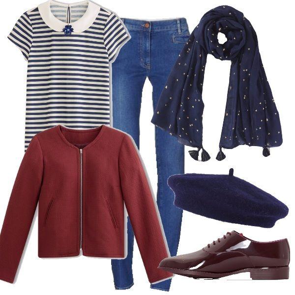 Un look comodo e pratico per vivere la quotidianità con stile. Un paio di jeans con t-shirt, una giacca corta color mattone, colore di quest'autunno, richiamato anche dalle scarpe in vernice. Per combattere il freddo, sciarpa e basco sul blu.