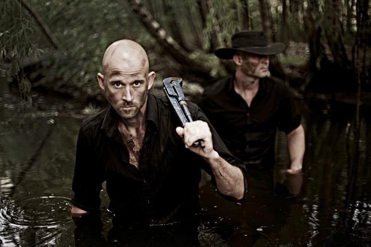 working men in swamp