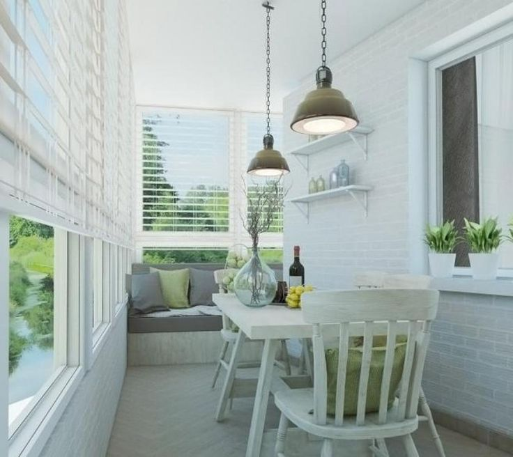 http://www.drissimm.com/wp-content/uploads/2015/02/contemporary-ideas-for-design-balcony-with-pendant-lamp-above-white-table-set-plus-vases-on-the-top-also-white-shades-window-and-sofa-in-the-nearby.jpg