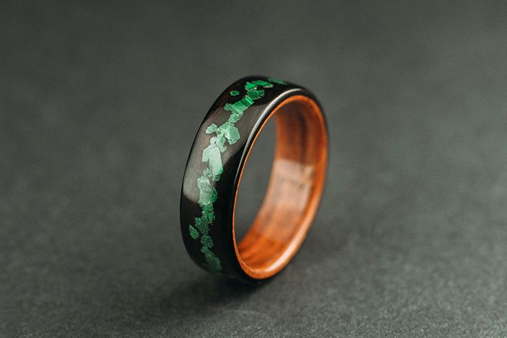 Hello, This listing is for a ring made from makassar ebony wood, lined with santos rosewood and crushed malachite stone inlay.  The ring shown here is 6 mm wide but you can choose another width from the menu. It is coated with multiple layers of a high quality membrane glossy finish and a final Renaissance wax polish, witch makes it water proof, however I recommend avoiding excessive water contact (ex. when taking a shower /bath/dish washing) for a long lasting finish.   I believe t...