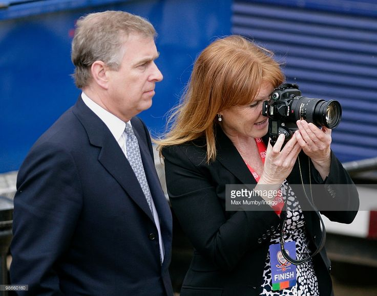 HRH Prince Andrew, The Duke of York and ex-wife <a gi-track='captionPersonalityLinkClicked' href=/galleries/search?phrase=Sarah+Ferguson+-+Hertogin+van+York&family=editorial&specificpeople=160596 ng-click='$event.stopPropagation()'>Sarah Ferguson</a>, The Duchess of York (taking photographs) wait by the finish line of the Virgin London Marathon for daughter HRH Princess Beatrice of York to complete the marathon as part of the 'Caterpillar Run' Team, consisting of 32 runners tethered together…