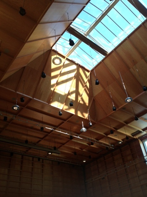 The packaging protecting the roof-lights in the new concert-hall are removed as the building nears its completion.