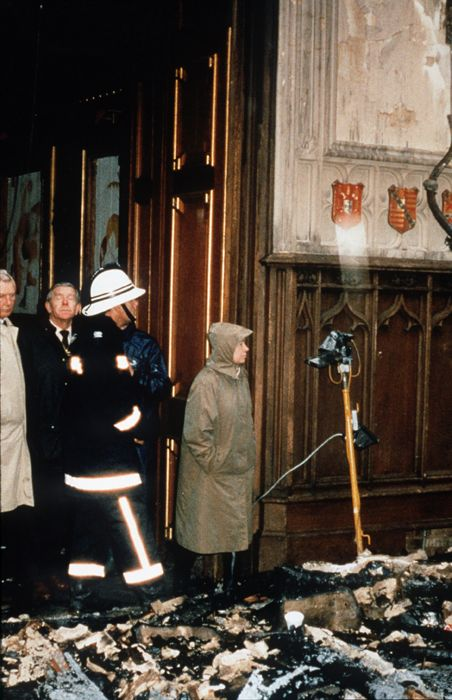 Scene of the fire.  The desolate monarch inspects the damage at her beloved Windsor Castle in 1992.