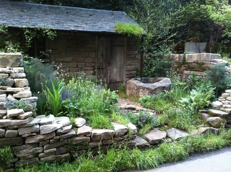 Dry stone wall garden indoor outdoor spaces pinterest for Rock wall garden