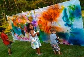 outside messy art just get a really old bed sheet even with stain thinking about getting rid of well hang it out side on a clothes line use cloth pins to hold the sheet and get your kids to be creative this also enhances creativity and get involve with them as well fr the whole family to enjoy