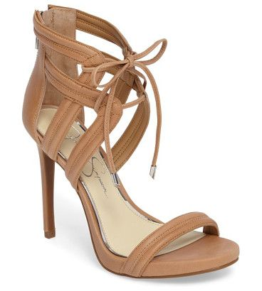 rensa sandal by Jessica Simpson. Slender ties cinch the cage straps of a statement sandal lofted by a towering stiletto heel and a hint of platform.