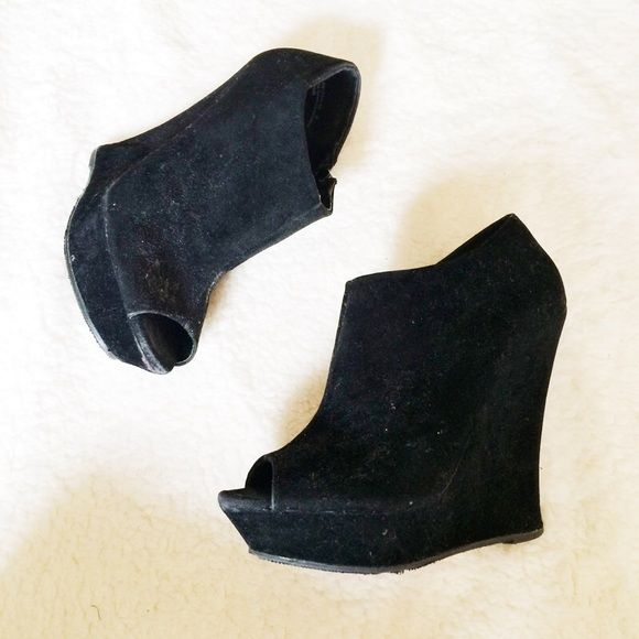 Black Peep Toe Wedges These have only been worn a couple times. The flaws are shown above. Heels: 5in. including 1in. platforms.  ✅Reasonable offers welcome! ✅BUNDLE DISCOUNTS! No trades/paypal/other apps. No lowball offers. Bamboo Shoes Wedges
