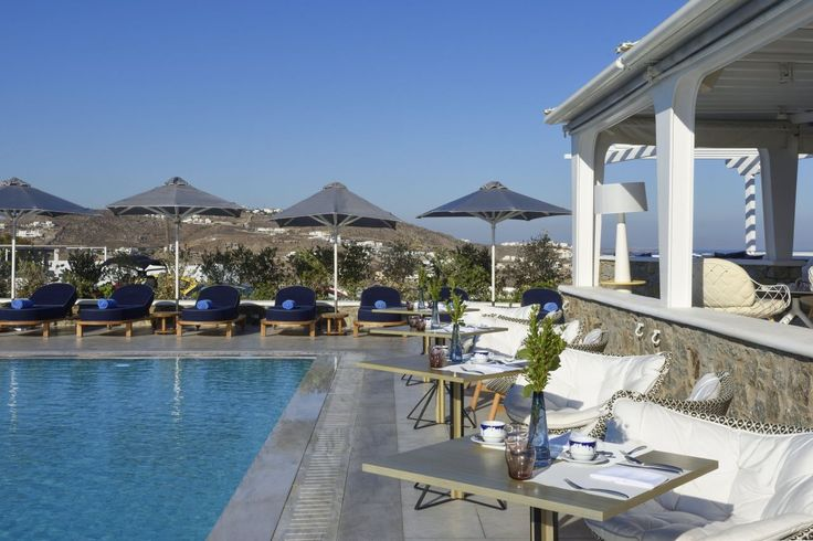 Lounge in our generously-sized pool deck with a panoramic view ! #Discover #MyconianKyma #Pool #Wonderful #Vacations