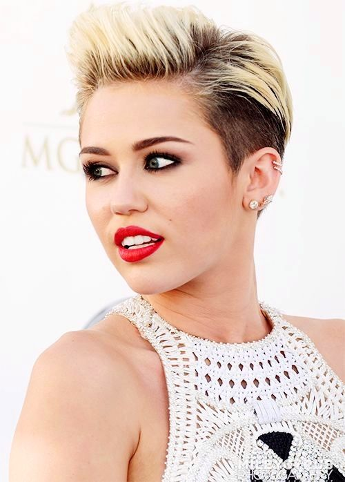 Love her new signature look... Two toned shaved head and bright red lipstick. Love her!