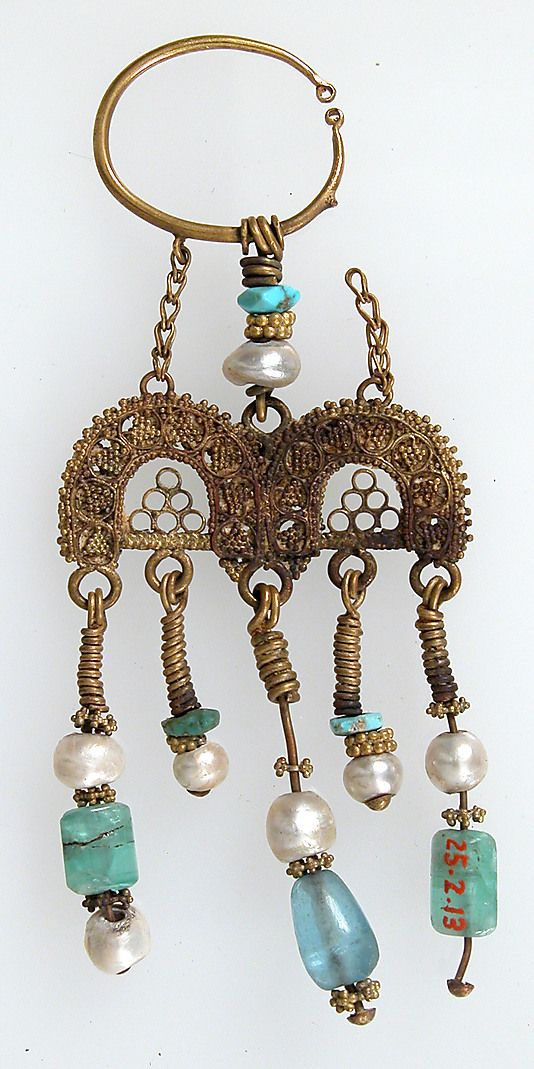 Earring ~ 2nd–3rd century  Geography:      Made in, Kharga Oasis, Byzantine Egypt  Culture:      Coptic  Medium:      Gold, semi-precious stones