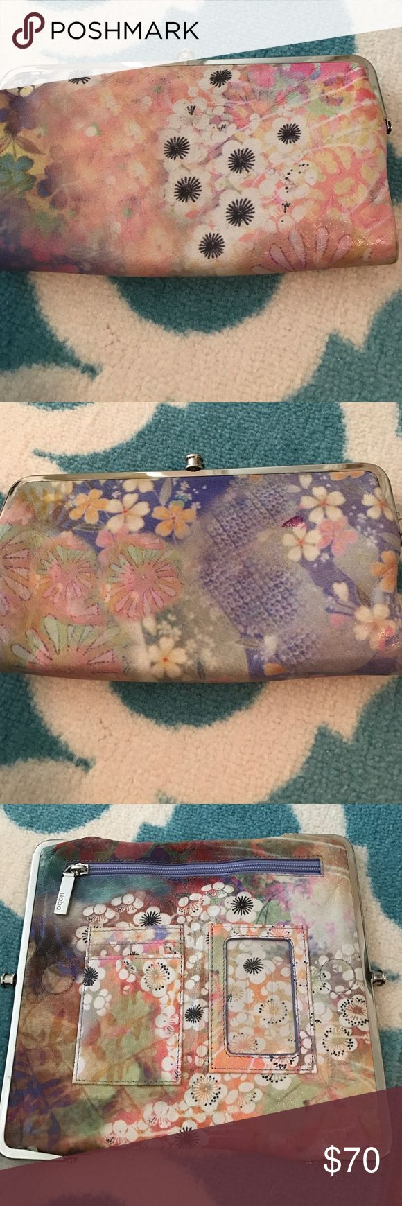 Hobo brand wallet Large wallet with lots of pockets! Could be used as a clutch. Flower pattern with light pink and purple and yellow HOBO Bags Wallets