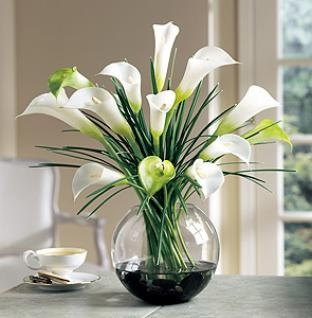 Lilies, love the arrangement.  clean, simple and elegant.