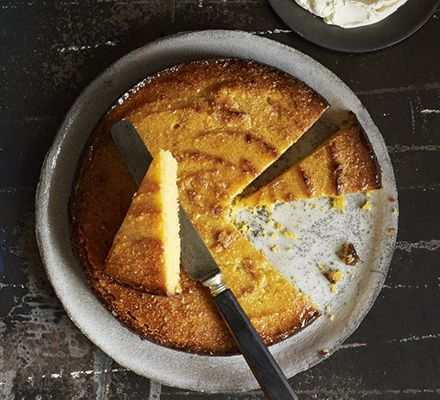 Flourless lemon & polenta drizzle cake. This gluten-free citrus cake has a grown-up bitter edge. Serve with creamy mascarpone and black coffee