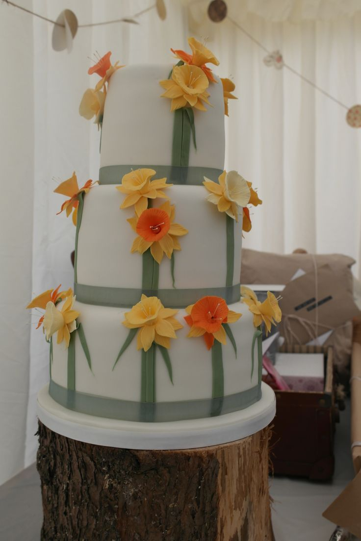 Our wedding cake which reflected the proposal - my husband wrote 'Marry Me?' in daffodils which sprouted on the field where we got married. Such a perfect proposal.