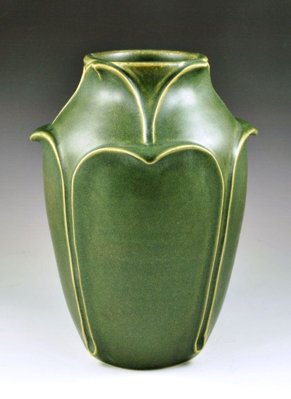 "JW Art Pottery - Grueby Style Leaf Vase - This vase is based on one of Grueby's rarest and most important forms. It is decorated with rows of leaves in very high relief, stands approximately 7 1/4"" tall, and is glazed with a jade green matte glaze."