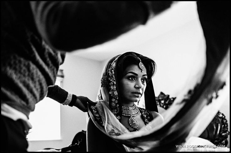 Careful framing as Sheena finishes her preparations before marrying Jason at Froyle Park -