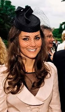 Duchess Catherine in black Issa dress, pink jacket, pink Prada clutch, and Jane Corbett fascinator at the wedding of Peter Philips and Autumn Kelly, May 2008.