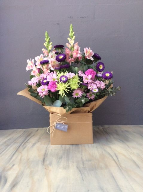 Pretty Pink and Purple combination in this Natural Elegance Boxed Arrangement. Snapdragon, Chrysanthemum and Asters