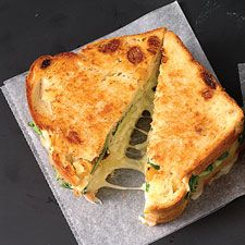 delicious grilled cheese with apple and arugula:  8 slices Fruited Sourdough Sandwich Bread  1/4 cup (4 tablespoons) soft unsalted butter  1/2 cup Granny Smith apple, thinly sliced  1 ounce baby arugula  8 ounces sliced sharp cheddar cheese