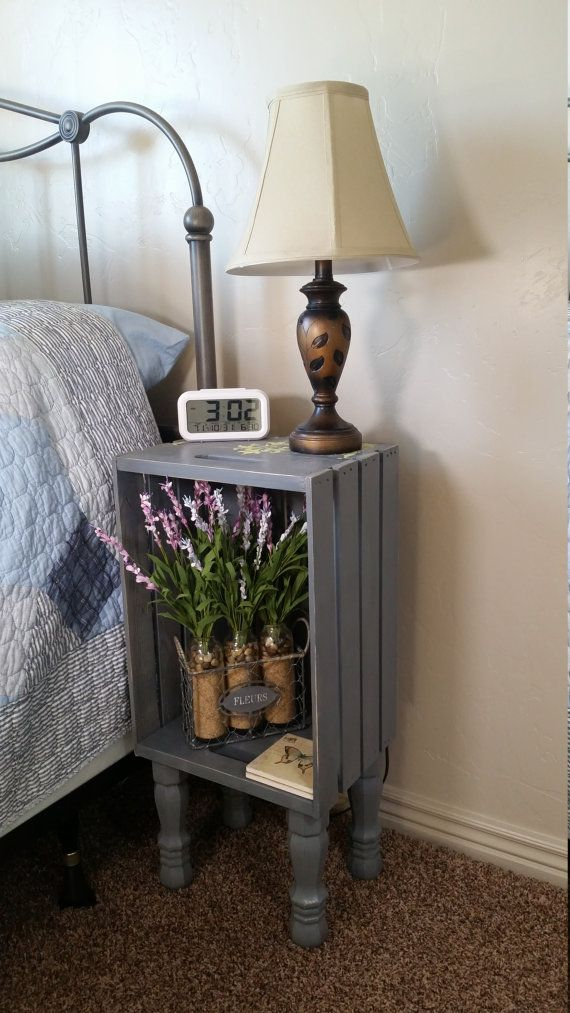 This cute dark gray painted crate nightstand is a perfect addition to your home. With Cute little legs this nightstand is unique. These nightstands are very sturdy even though they are somewhat tall. #DIY #HomeDecor